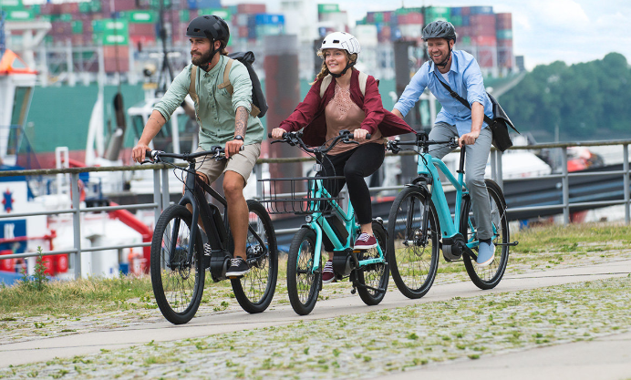 3 people riding electric bikes