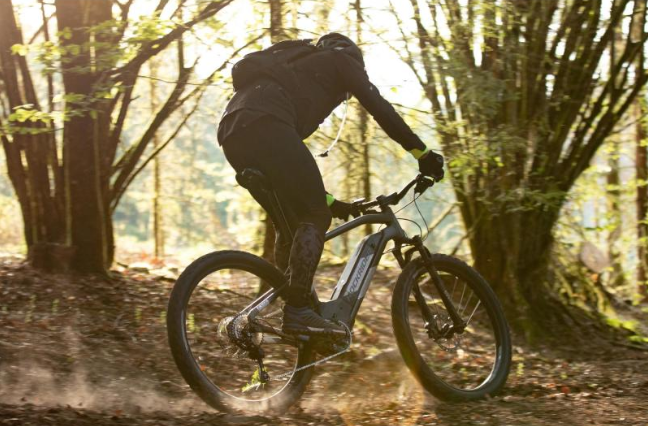 man riding an electric mountain bike off road