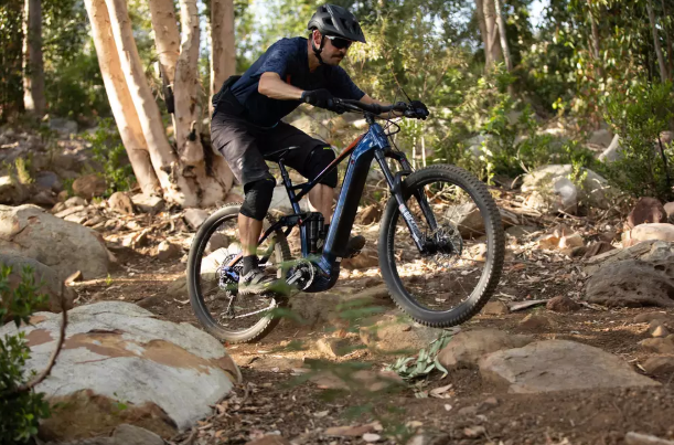 decathlon stylus electric mountain bike being ridden off road